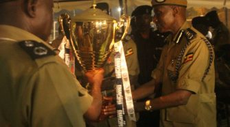 Gen Kale receives a trophy on behalf of Uganda Police Force.