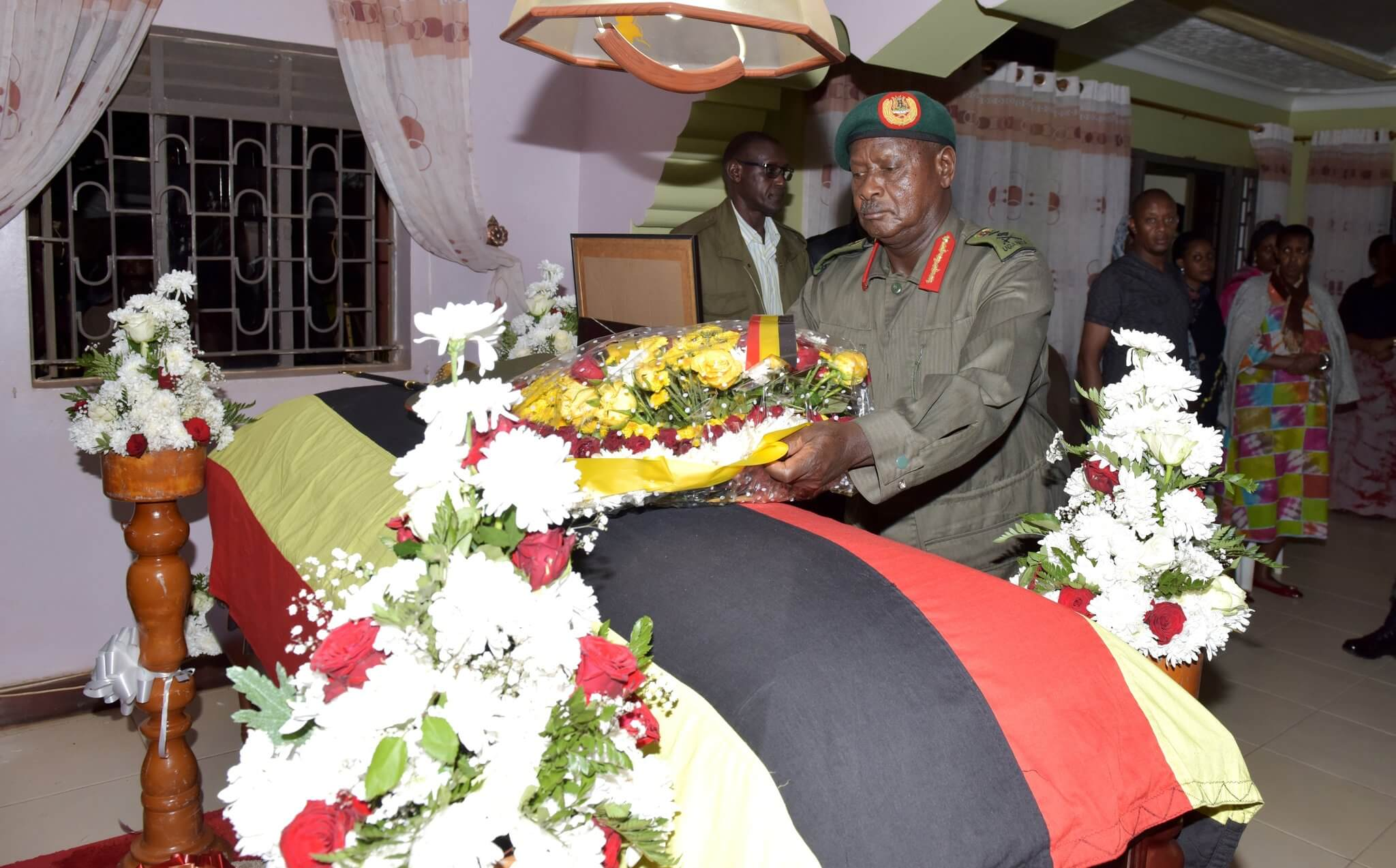 President Yoweri Museveni lays a wreath at the casket containing remains of Brig Geoffrey Taban Kyabihende at his home in Bunga on Wednesday
