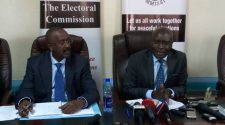 Electoral Commission; Chairman Justice Simon Byabakama (R) and Secretary Sam Rwakoojo (L) during a press conference on Wednesday