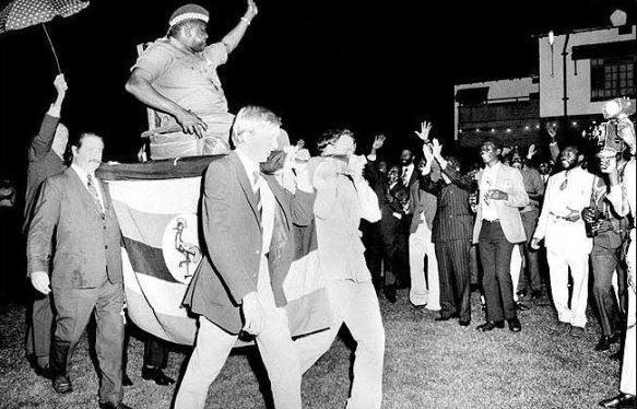 President Amin being carried by British citizens before declaring conquest of the British empire