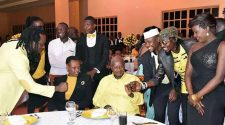 Museveni fist bumps with Radio during a state dinner at which the President hosted artists.